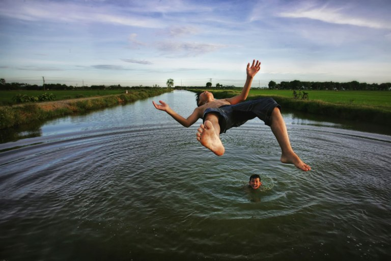 Boy Jump In River
