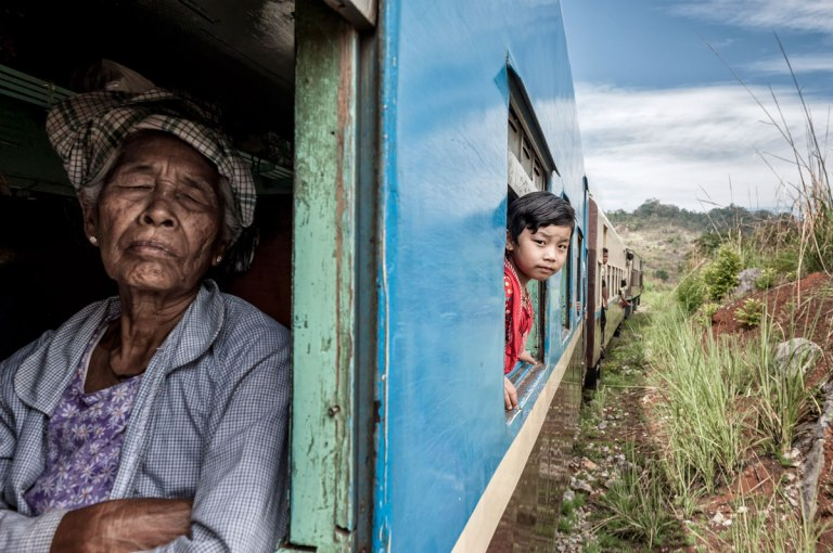 Window, Moving Train, Old Woman & A Girl