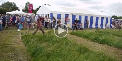 Old School Cool: Guy with Giant Scythe Takes on a BrushCutter
