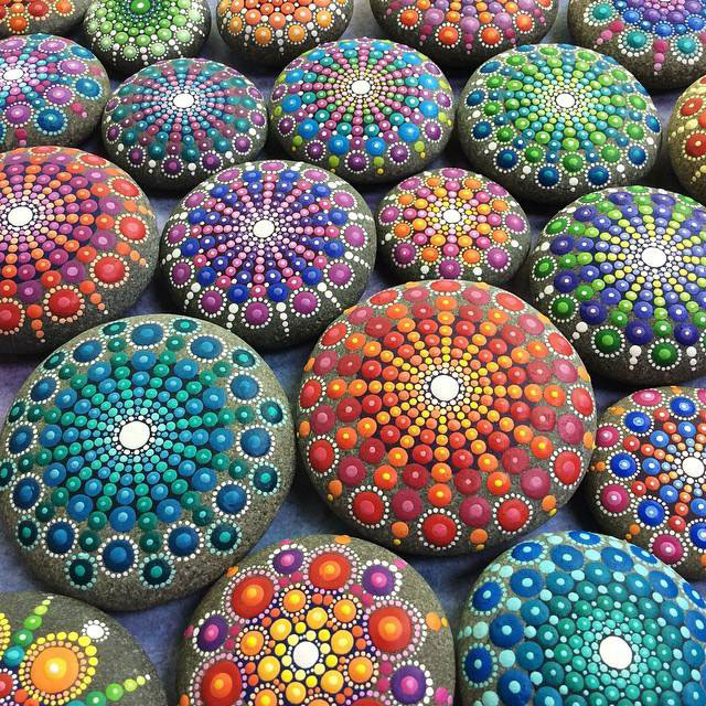 artist finds beautiful beach stones and covers them in tiny dots of paint twistedsifter. Black Bedroom Furniture Sets. Home Design Ideas