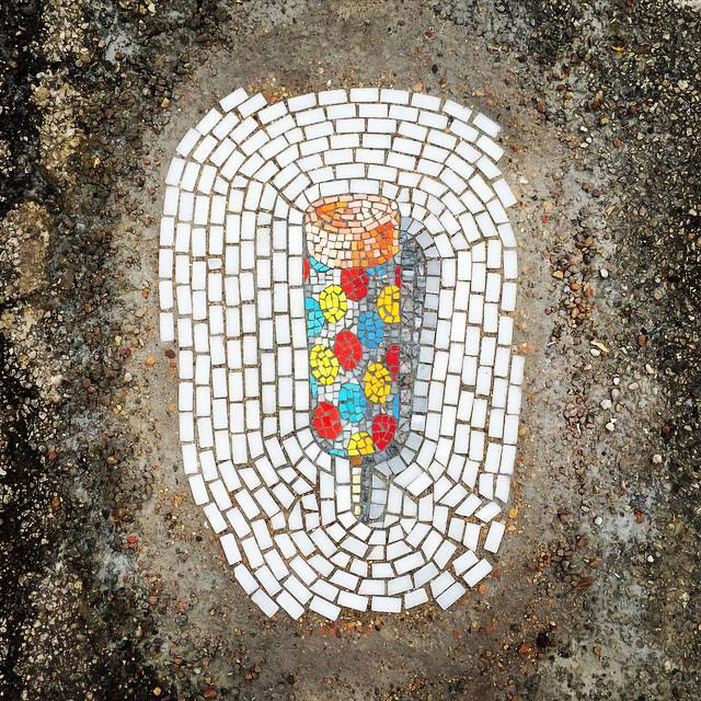 Artist Bachor Fills Potholes with Food and Flower Mosaics (2)