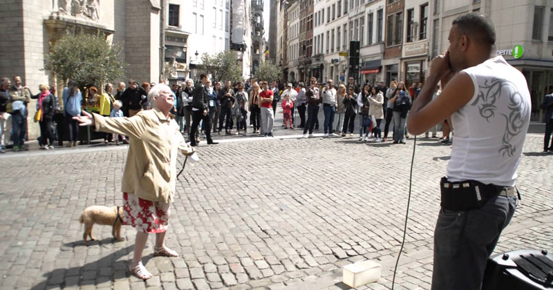beatbox-street-performer-in-brussels-woman-walking-dog-dancers-her-heart-out
