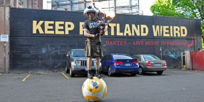 Just a Guy Riding a Giant Ball Playing Star Wars with a FlamingBagpipe