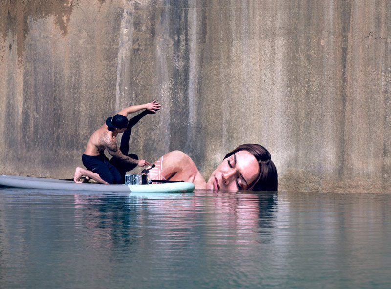 Street Artist HULA Uses Paddleboard to Paint in Hard to ReachPlaces