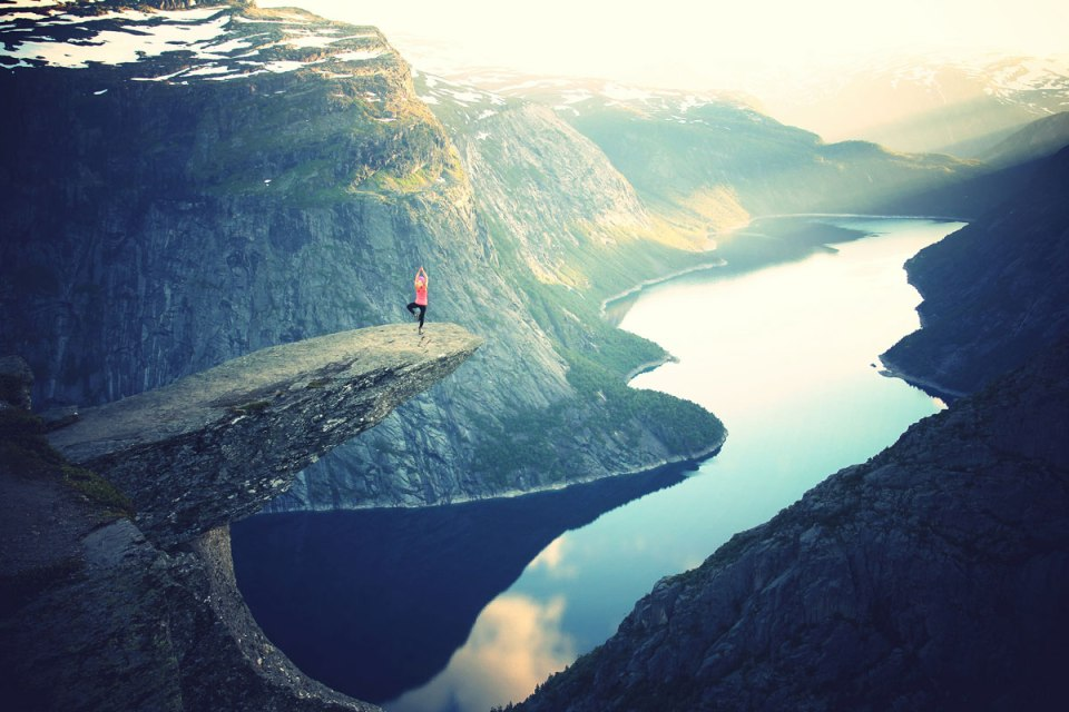 trolltunga norway tree pose The Top 50 Pictures of the Day for 2015