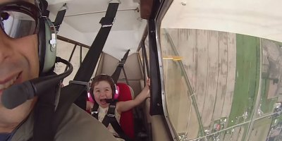 Dad Takes Daughter on Her First-Ever Airplane Loop and She Loves It