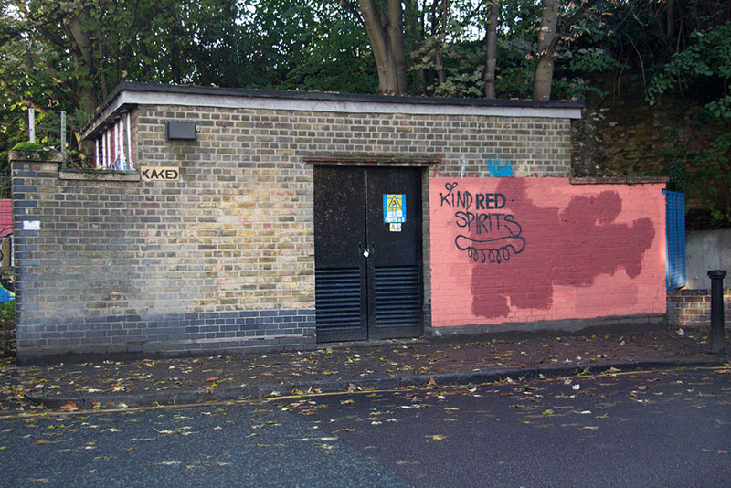 Street Artist mobstr and City Worker Have Year Long Exchange on Red Wall in London (12)
