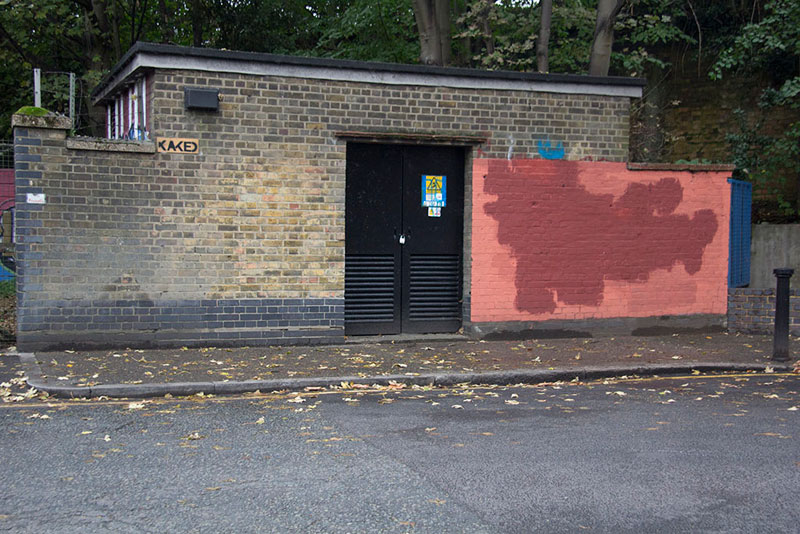 Street Artist mobstr and City Worker Have Year Long Exchange on Red Wall in London (15)