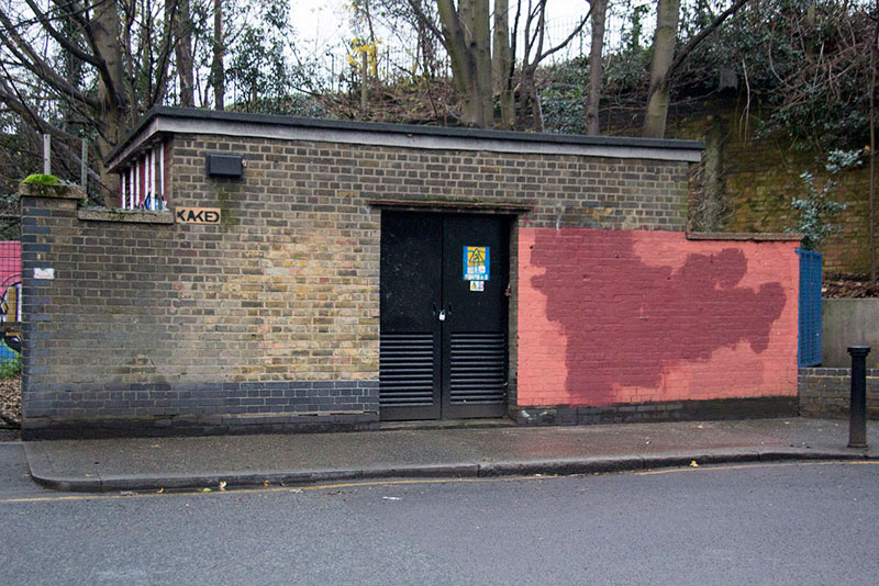 Street Artist mobstr and City Worker Have Year Long Exchange on Red Wall in London (17)