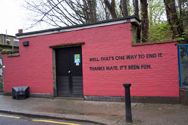Street Artist and City Worker Have Year Long Exchange on a Red Wall in London