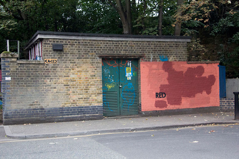 Street Artist mobstr and City Worker Have Year Long Exchange on Red Wall in London (5)