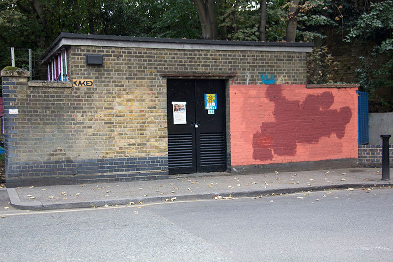 Street Artist mobstr and City Worker Have Year Long Exchange on Red Wall in London (6)