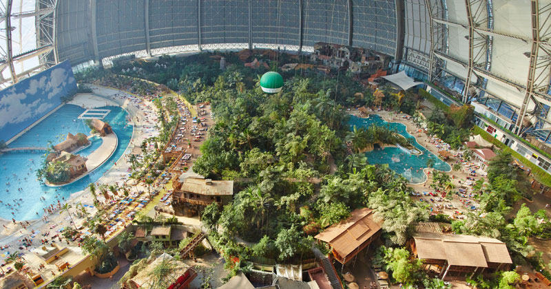 tropical islands resort the giant waterpark inside an old german airship hangar cover A Clever Hotel Room Loft Designed for Longer Stays