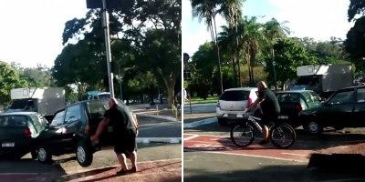 Cyclist Lifts a Car Off a Bike Path, Rides Away aLegend