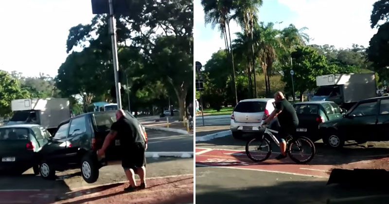 cyclist-lifts-car-off-of-bike-path-rides-away-a-legend