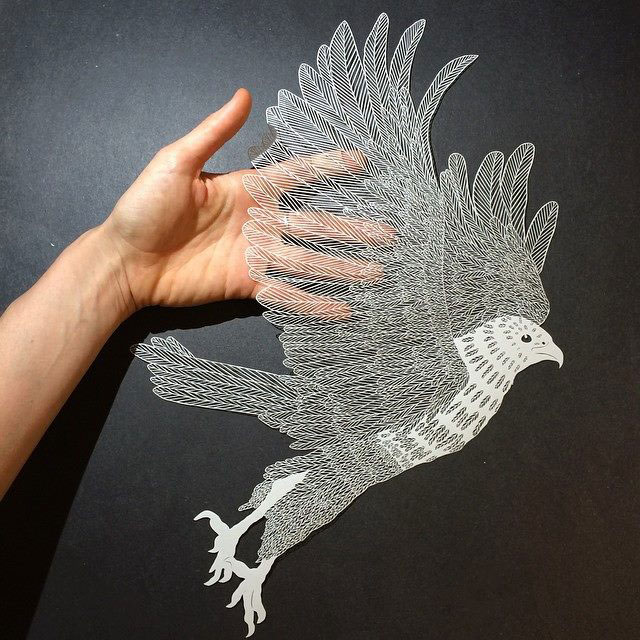 Paper plants and animals cut by hand with a surgical knife