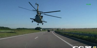 Riding With a Helicopter Down a Highway in Ukraine