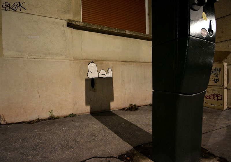 snoopy lying on doghouse shadows oakoak street art Picture of the Day: Lying in the Shadows