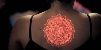 Artists Bring Tattoos to Life with Live Projection Mapping