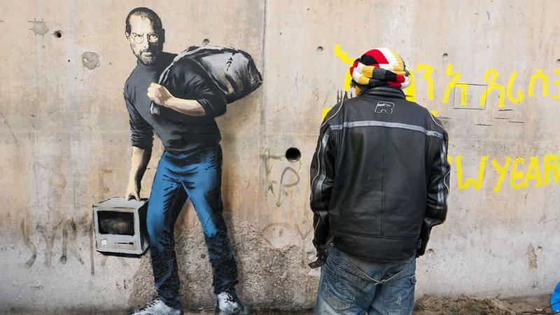 New Banksy Mural of Steve Jobs Highlights RefugeeCrisis