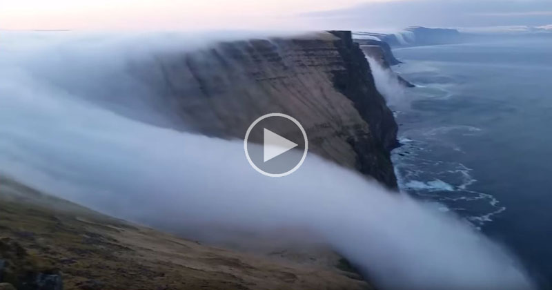 Fog Rolls Over Cliff Like a Waterfall