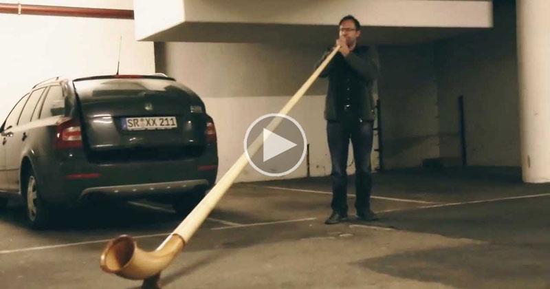 Guy Plays Alphorn Inside Underground ParkingLot