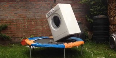 A Brick, Inside a Washing Machine, on aTrampoline