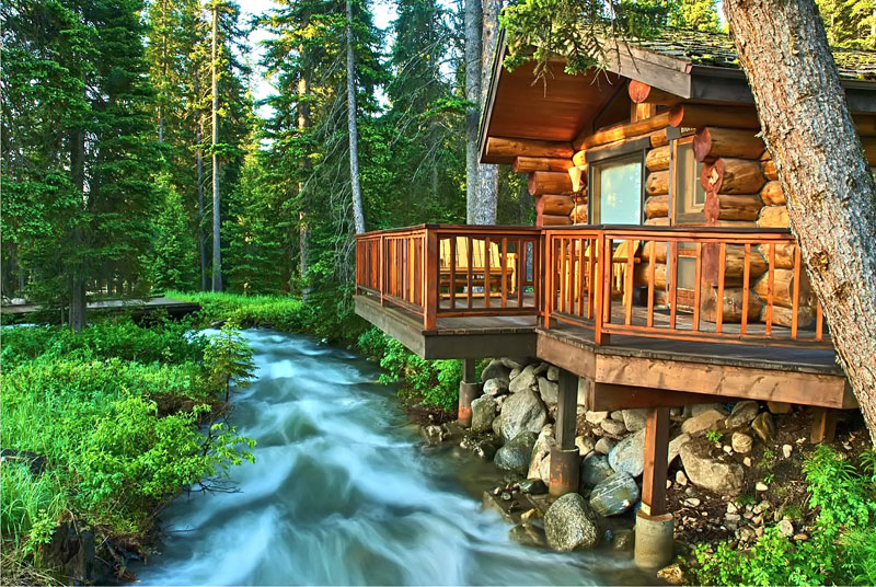 National geographic unique lodges of the world 12 photos for Texas cabins in the woods
