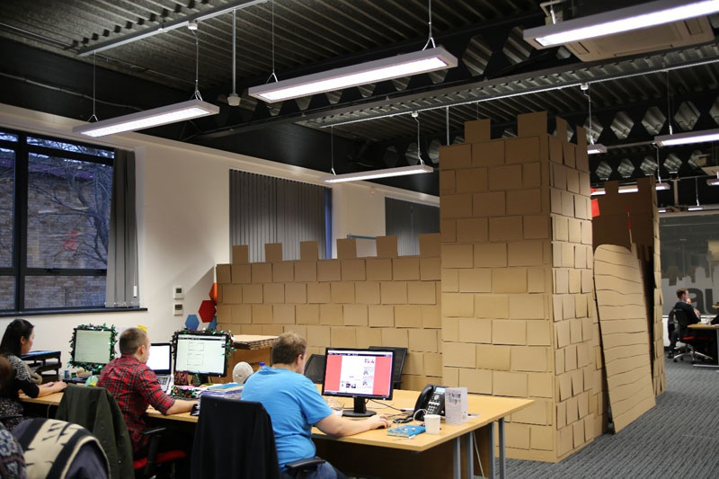 Boss told them to jazz up their cubicle so they built a cardboard castle with drawbridge - Viking office desk ...