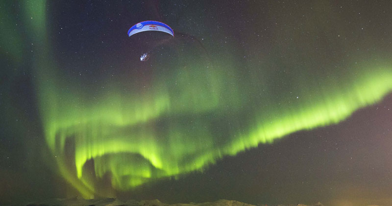 Guy Goes Paragliding Through Aurora Borealis in Norway