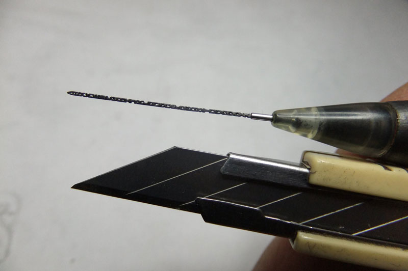 Just the entire alphabet carved into mechanical pencil