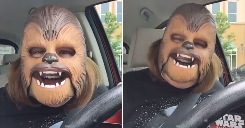 woman-wearing-chewbacca-mask-laughing-hysterically