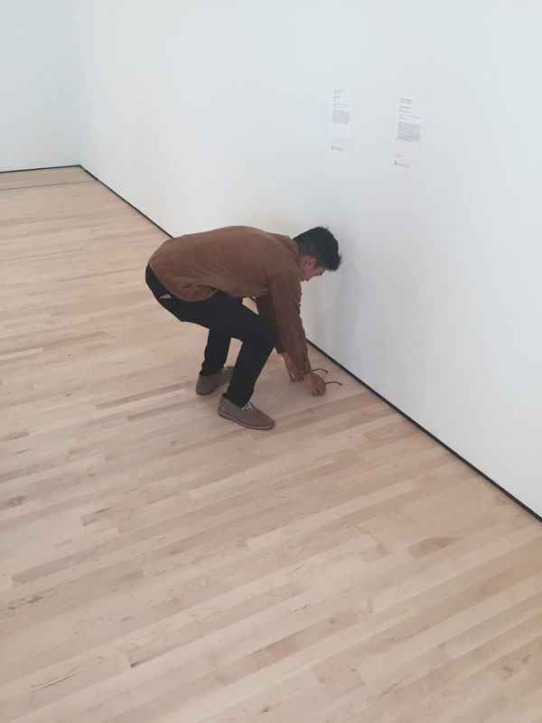 Guy Puts His Glasses On The Museum Floor And People
