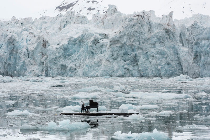 Musician Plays Piano in the Middle of the Arctic as Calving Glaciers Crash Behind Him
