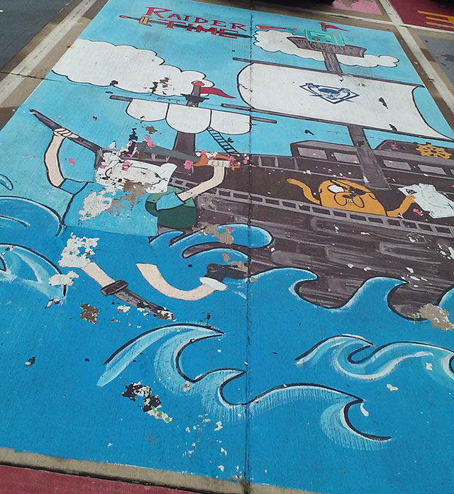 High Schools Let Their Seniors Paint Their Parking Spots (10)
