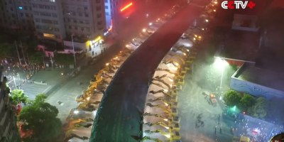 Watch 116 Excavators Demolish an Aging Overpass in a Single Night