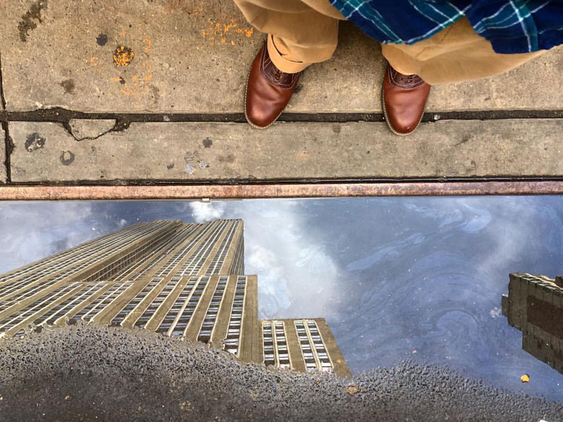 empire state building puddle reflection by ben hipp Picture of the Day: Empire State Puddle Reflection