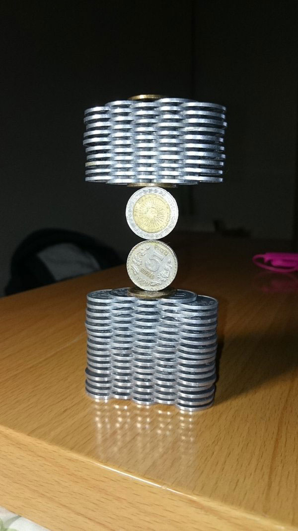 amazing coin stacking by thumb tani on twitter 21 Next Level Coin Stacking by @Thumb Tani