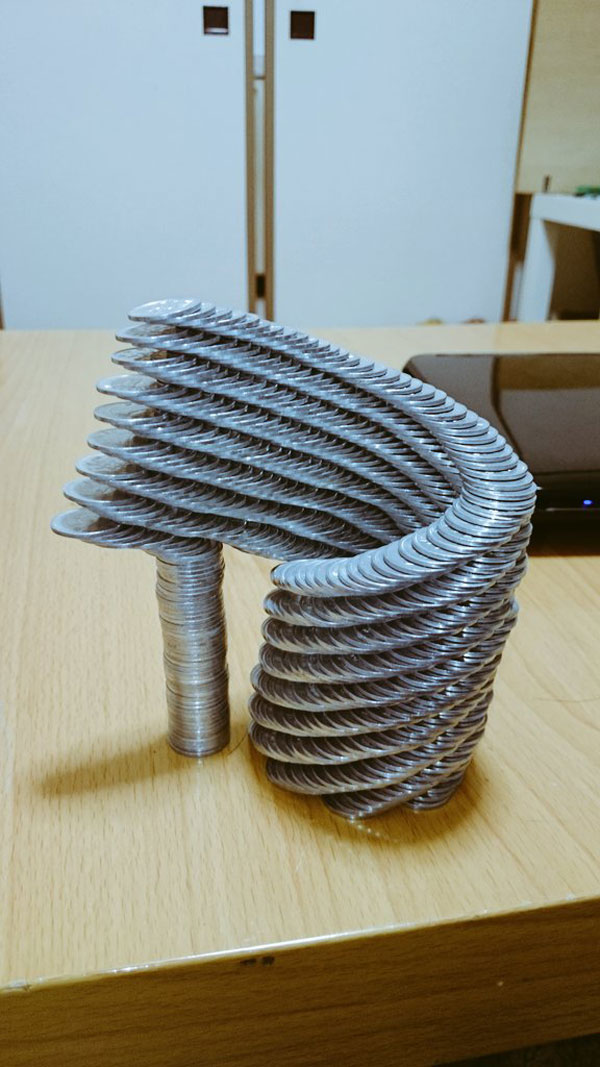 amazing coin stacking by thumb tani on twitter 25 Next Level Coin Stacking by @Thumb Tani