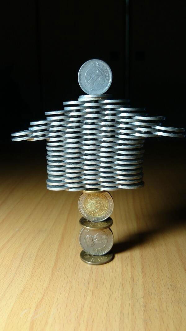 amazing coin stacking by thumb tani on twitter 3 Next Level Coin Stacking by @Thumb Tani