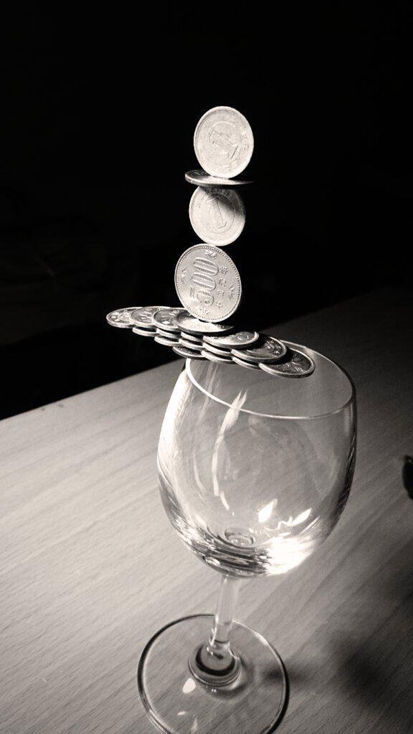 amazing coin stacking by thumb tani on twitter 7 Next Level Coin Stacking by @Thumb Tani