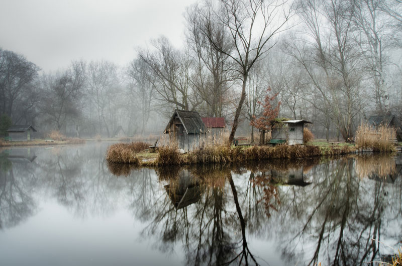 fishing lake in hungary looks frozen in time 1 This Hungarian Fishing Lake Looks Frozen in Time (11 Photos)