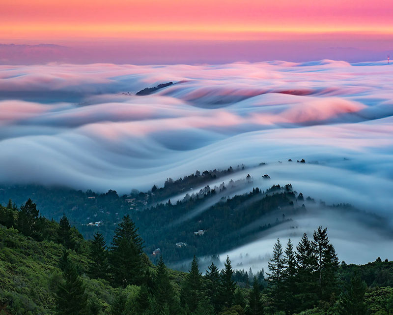 fog waves by nick steinberg 1 Photographer Captures Fog Waves That Look Like Oceans in the Sky