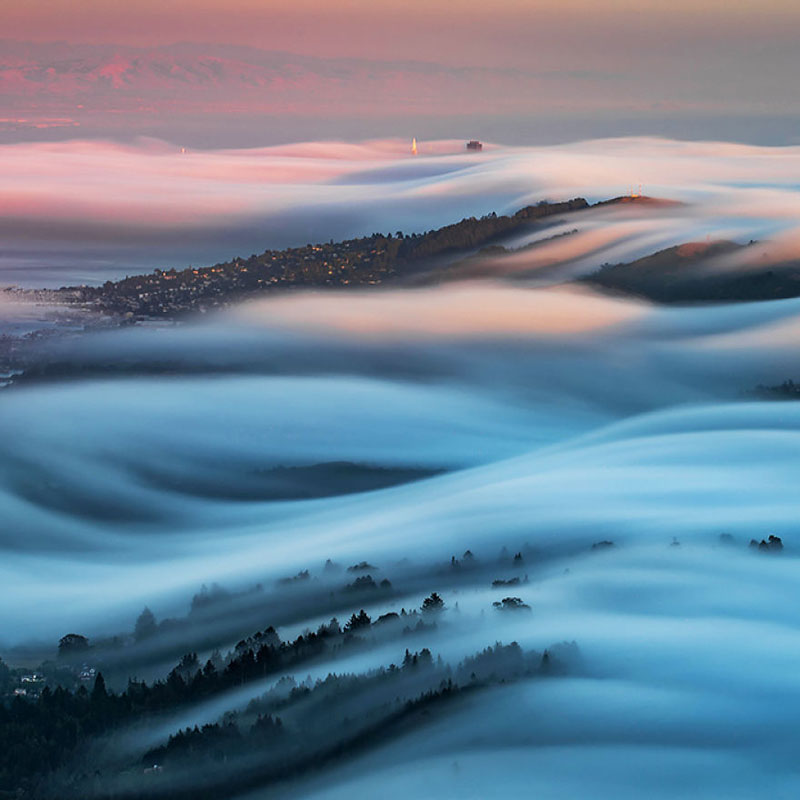 fog waves by nick steinberg 2 Photographer Captures Fog Waves That Look Like Oceans in the Sky