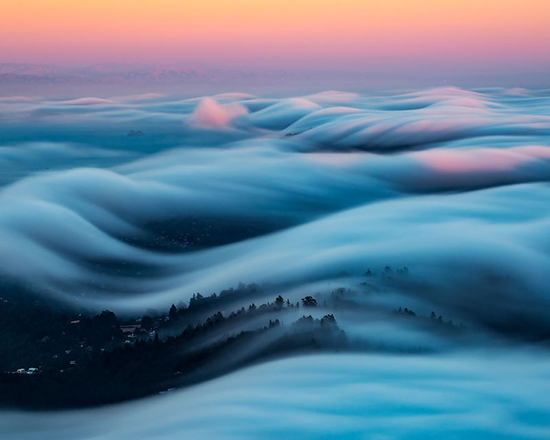 fog waves by nick steinberg 4 Photographer Captures Fog Waves That Look Like Oceans in the Sky