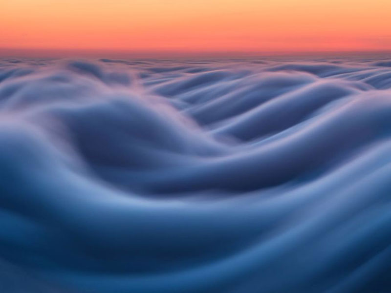 fog waves by nick steinberg 6 Photographer Captures Fog Waves That Look Like Oceans in the Sky