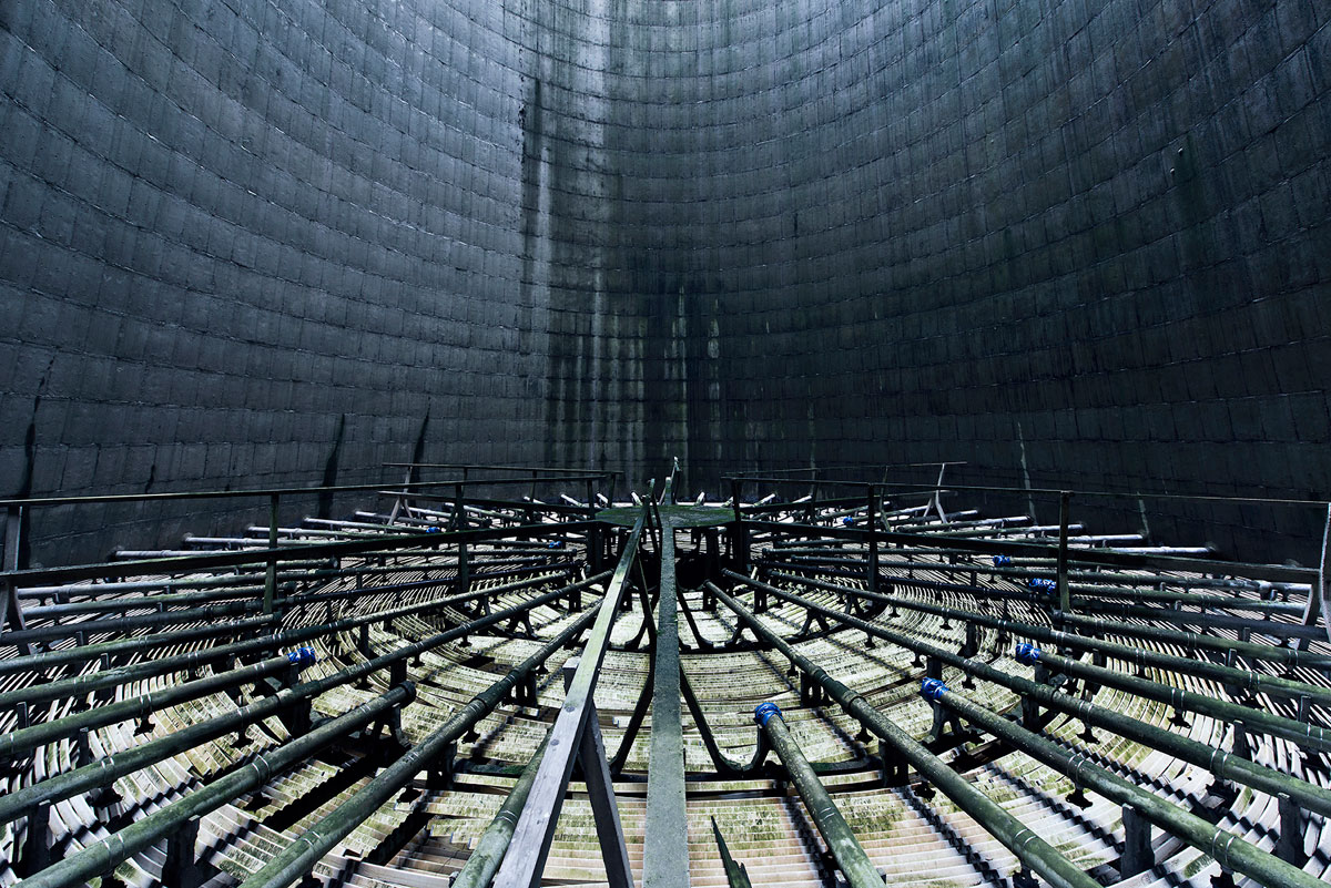 abandoned cooling towers by reginald van de velde 13 The Insides of these Abandoned Cooling Towers Look Straight Out of a Sci Fi Film