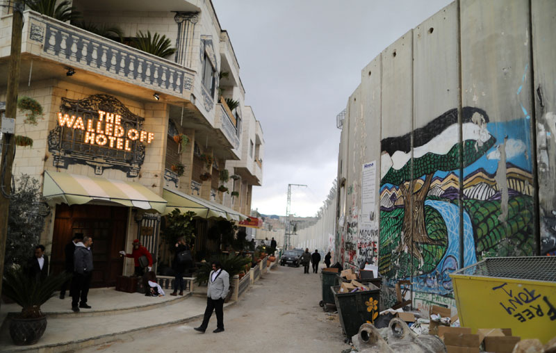 banksy hotel west bank palestine Banksy Opens Art Hotel with Worlds Worst View