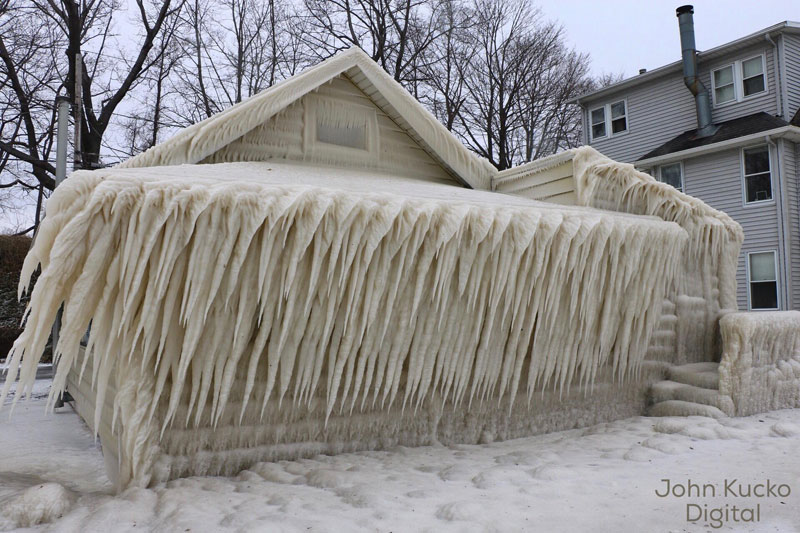 house incased in ice by john kucko digital 2 Crashing Waves, Strong Winds and Freezing Temps Encase Home in Ice