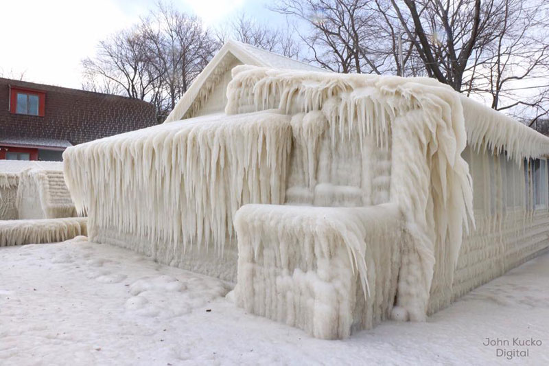 house incased in ice by john kucko digital 3 Crashing Waves, Strong Winds and Freezing Temps Encase Home in Ice